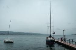 Sailing ships on a lake at a rainy day