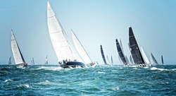 Sailing ships race. Beautiful sailboats under sail on a cruise regatta. Travel and tourism at sea