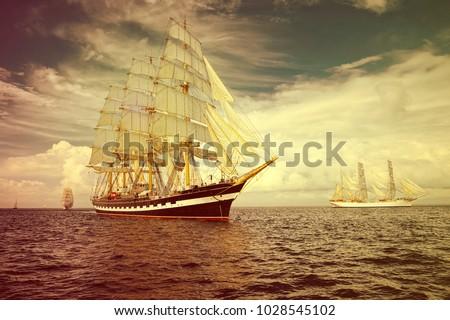 Sailing ships race. Yachting. Sailing #1028545102