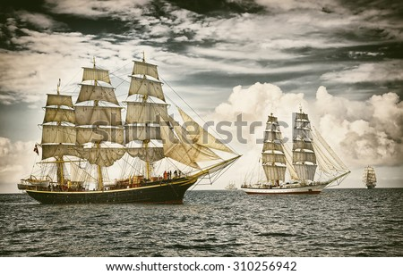 Sailing ships under sail. Toned image and blur. Retro style postcard. Sailing. Yachting. #310256942