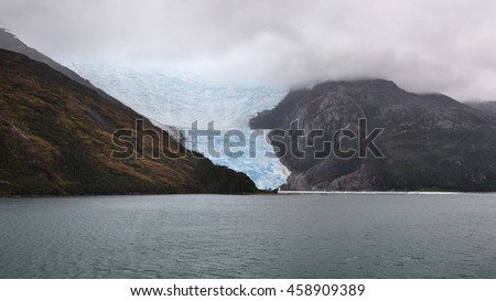 Sailing through the Beagle Channel. Dramatic view of Chilean fjords and Italia Glacier. Beagle Channel is a strait on the extreme southern tip of South America partly in Chile and partly in Argentina stock photo