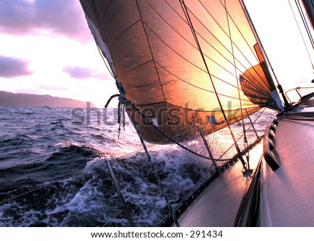 sailing to the sunrise - stock photo