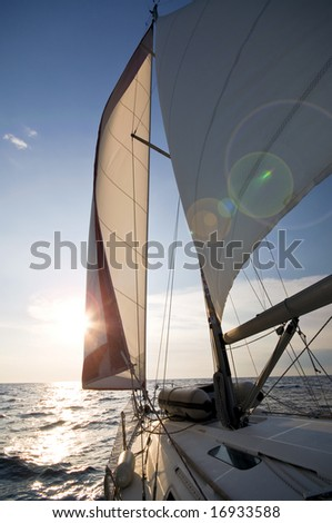 sailing towards sunset