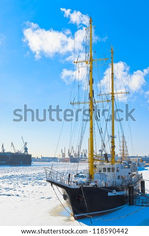 Sailing vessel against port. Neva river. St.-Petersburg. Russia