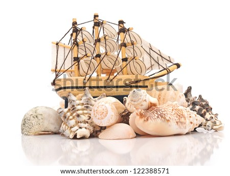 Sailing vessel and sea shells on white background