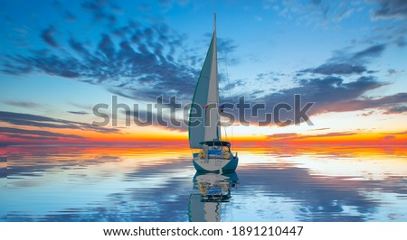 Sailing Yacht from sail regatta on mediterranean sea at sunset - Sailing luxury yacht with white sails in the Sea.
