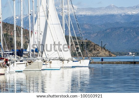 Sailing yacht get her's sail dry in the marina. Mediterranean sea.