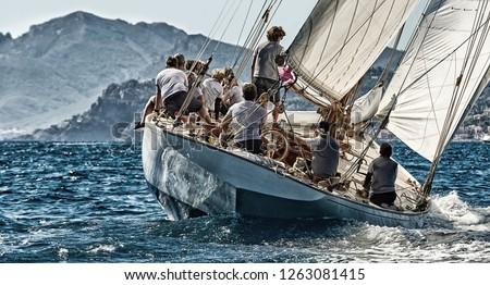 Sailing yacht race regatta. Sailboat in the sea under sail. Yachting sport