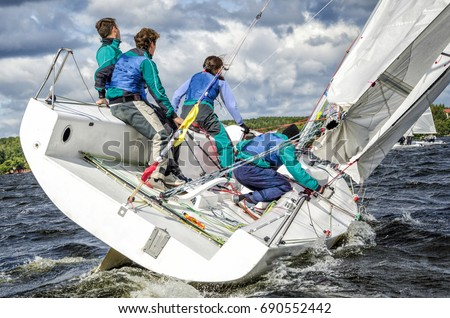 Sailing yacht race, regatta. Sailboat. Recreational Water Sports, Extreme Sport Action. Healthy Active Lifestyle. Summer Fun Adventure. Hobby. Gender Equality