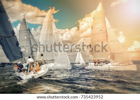 Sailing yacht race, regatta. Sailboat. Recreational Water Sports, Extreme Sport Action. Healthy Active Lifestyle. Summer Fun Adventure. Team athletes participating in the sailing competition