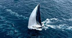 Sailing yacht under full sail at the regatta