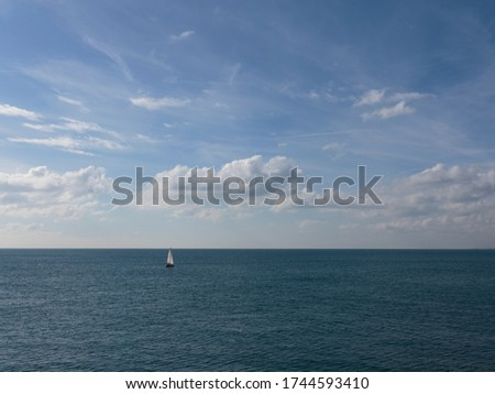 Sailing Yatch in the distance from Brighton Palace Pier, Brighton, England