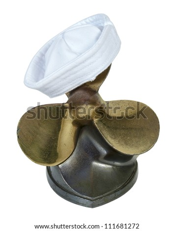 Sailor hat on a set of propeller and  blades used on a boat engine to propel through the water