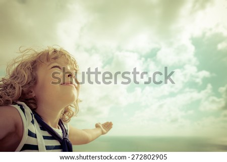 Sailor kid looking ahead against summer sky background #272802905