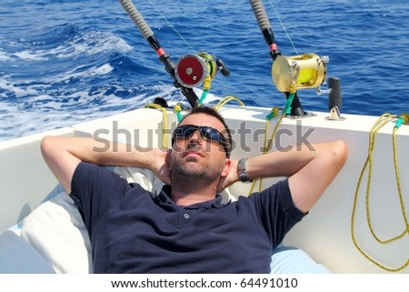 Sailor man fishing resting in boat summer vacation blue sea