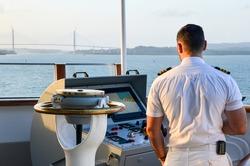 Sailor navigating Panama Canal from bridge.