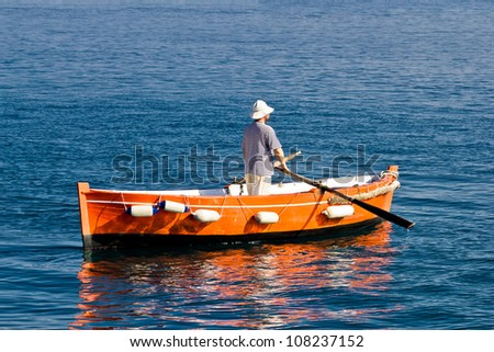 Sailor rowing on wooden taxi boat in Zadar, Croatia #108237152