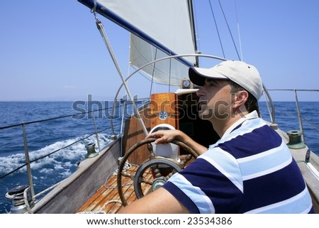 Sailor sailing in the sea. Sailboat over mediterranean blue saltwater