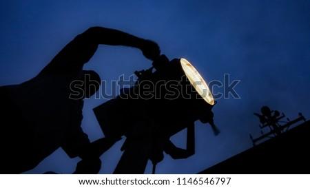 Sailor sends mos code via flashing light during ship's underway. Stock fotó ©