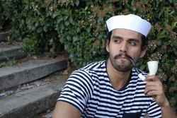 Sailor smoking with retro pipe