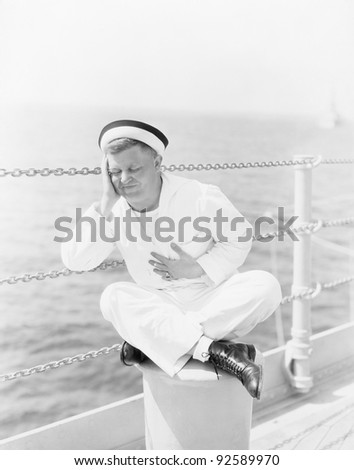 Sailor suffering from stomachache on the ship - stock photo