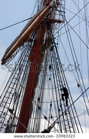 Sailors at masts of sail ship