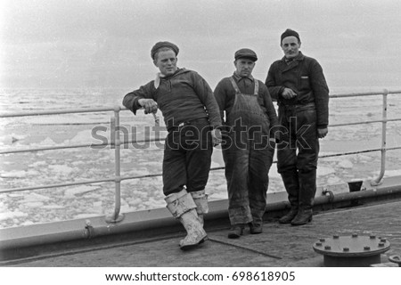 Sailors standing on deck of moving ship #698618905