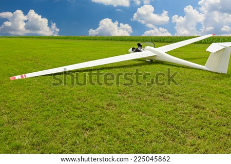 Photo of  Sailplane, glider airplane wide angle shot on the ground field waiting for take-off.