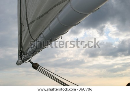 Sails of a boat with clouds in the background