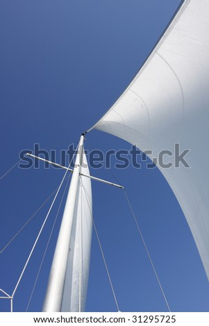 Sails on a sailboat catching wind. #31295725