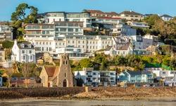 Saint Aubin town seashore view with Sacred heart of Jesus church,, bailiwick of Jersey, Channel Islands