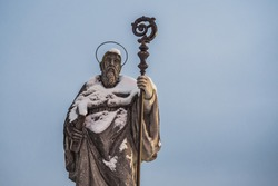Saint Benedict of Nursia Statue on Sonntagberg in the  Mostviertel or Must Quarter of Lower Austria covered with Snow. Reproduction of a Sculpture made in 1735 by Pietro Poaloa Campi in Monte Cassino