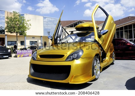 SAINT-CHRISTOLE-LES-ALES, FRANCE - JULY 27: Car tuning exhibition in Saint-Christole-les-Ales in the French department of Gard, july 27, 2014.