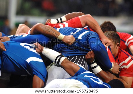 SAINT-ETIENNE, FRANCE-SEPTEMBER-27, 2007: Samoa and USA rugby players scrum during the match USA vs Samoa, of the Rugby World Cup, France 2007, in Saint-Etienne.