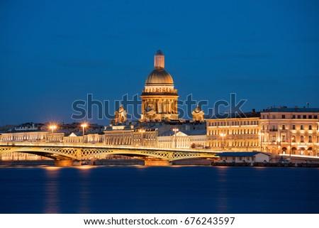 Saint Isaac's Cathedral and Blagoveschensky bridge with night illumination #676243597