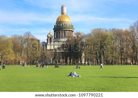 Saint Isaac's Cathedral Scenic View with People Relaxing on Grass at the Park in St.Petersburg, Russia. Famous Travel Landmark, Popular European Tourist Destination, Attracts Many Tourists Every Year. #1097790221