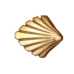Saint James way shell golden metal on streets soil isolated on white [Photo Illustration]