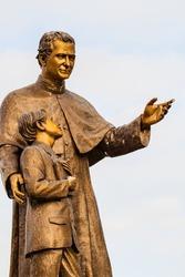 Saint John Bosco and Saint Dominic statue.