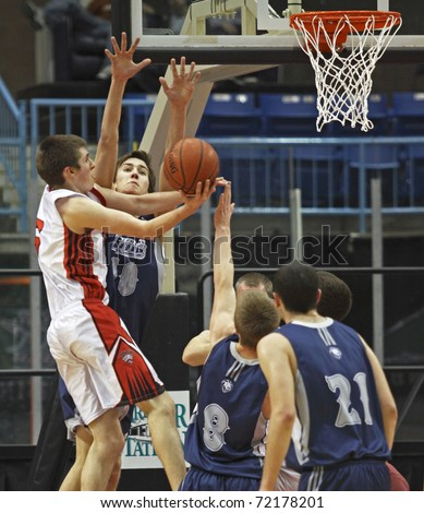 SAINT JOHN, CANADA - FEBRUARY 26: Leo Hayes' Sean Nugent tries to block a shot at the N.B. high school senior boys AAA basketball final on February 26, 2011 in Saint John, Canada.  Bathurst won 98-89.