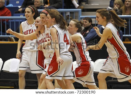 SAINT JOHN, CANADA - FEBRUARY 26: Riverview celebrates their 71-48 win over Woodstock at the NB high school senior girls AAA basketball final February 26, 2011 in Saint John, Canada.