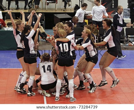 SAINT JOHN, CANADA - MARCH 12: Mount Royal University celebrates their gold win versus Vancouver Island University at the CCAA women's volleyball nationals March 12, 2011 in Saint John, Canada.