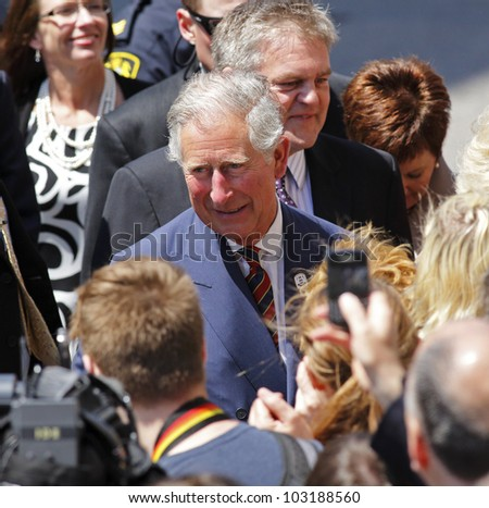 SAINT JOHN, CANADA - MAY 21: Charles, Prince of Wales, greets the public on a walkabout on Prince William Street on May 21, 2012, in Saint John, Canada.