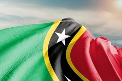 Saint Kitts and Nevis national flag cloth fabric waving on beautiful sky.
