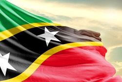 Saint Kitts and Nevis national flag cloth fabric waving on the sky with beautiful sun light - Image