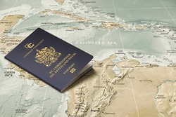 Saint Kitts and Nevis passport on a map of the Caribbean Sea, copy space