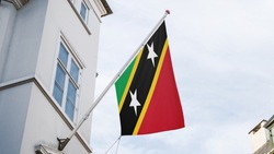 Saint Kitts and NevisFlag outside building for advertising, award, achievement, festival, election. National Flag of Saint Kitts and Neviswaving on Pole