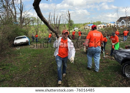 SAINT LOUIS, MISSOURI - APRIL 22:  Volunteers with Service International help residents of St. Louis with clean up efforts after tornadoes hit the Saint Louis, Missouri area on Friday, April 22, 2011. - stock photo