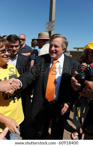 SAINT LOUIS, MISSOURI - SEPTEMBER 12: Dick Morris shaking hands at rally of the Tea Party Patriots in Downtown Saint Louis under the Arch, on September 12, 2010 in Saint Loius, Missouri
