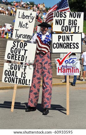 SAINT LOUIS, MISSOURI - SEPTEMBER 12: Man dressed in patriot costume holding signs at rally of the Tea Party Patriots in Downtown Saint Louis under the Arch, on September 12, 2010