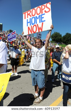 SAINT LOUIS, MISSOURI - SEPTEMBER 12: Man holding sign at rally of the Tea Party Patriots in Downtown Saint Louis under the Arch, on September 12, 2010